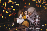 christmas love couple drinking a hot christmas punsch  - 232559050