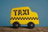 Toy taxi car. Wooden handmade toy car. Urban service concept. - 232560865