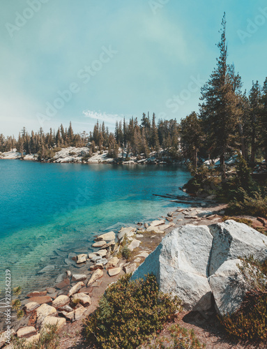 Deep Blue Isolated Crystal Lake in Mammoth, California - Isolated Crystal Lake in Mammoth Lakes, California, USA with deep blue water and green trees.
