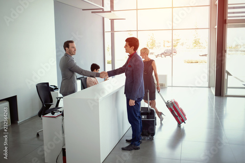 Leinwandbild Motiv business people arriving at the hotel reception.