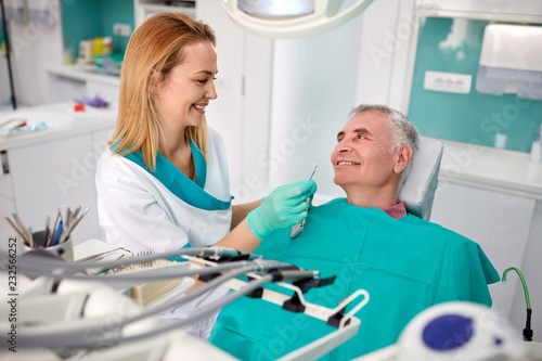 Senior patient in dental chair with female dentist - 232566252