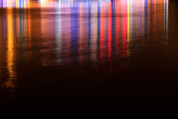 color light at night on the surface of water - 232591249
