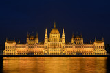 Night cityscape of illuminated Budapest parliament building with golden reflection in Danube river - 232615094