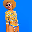 Lady beach country style. Fashion accessories hat and sunglasses. Trendy beach outfit