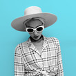 Girl country Western style. Fashion accessories hat and sunglasses. Checkered stylish shirt