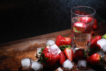 Fresh ripe strawberries on a wooden table