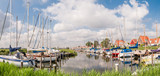 Marina with sailboats in dike village Durgerdam, IJmeer, Amsterdam, Netherlands - 232625825