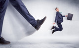 Giant leg kicking small businessman and he is flying away  - 232626881