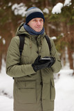 Man with a digital tablet outdoors - 232626882