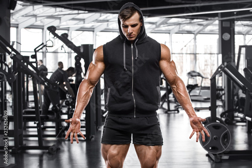 Sticker Muscular man working out in gym, strong male bodybuilder