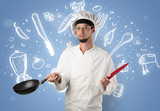 Young cook with kitchen instruments and drawn recipe concept on wallpaper - 232627478