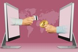commerce concept, two hands from computers. hand with credit card and hand with bitcoin. 3d illustration - 232627630