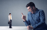 Young professional businessman being angry with an other miniature businessman  - 232631228