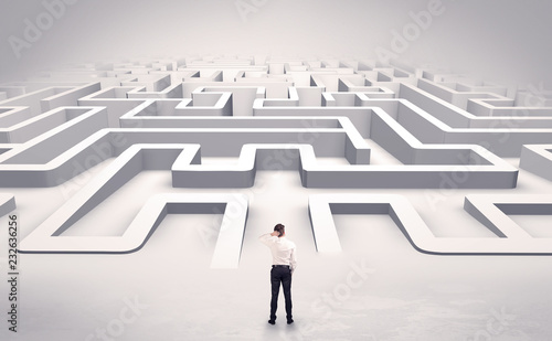 Businessman getting ready to enter a 3D flat labyrinth concept © ra2 studio