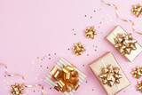 Fashion gifts or presents boxes with golden bows and star confetti on pink pastel background top view. Flat lay composition for birthday, christmas or wedding. - 232644279