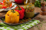 Colorful baked with cheese, stuffed peppers with rice and minced meat.
