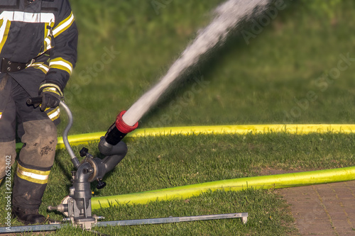 The fire department prepares the equipment and then exercises the use of water cannons. Concept: safety and protection or technology - 232652402