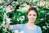 Calm and pretty young woman in the garden