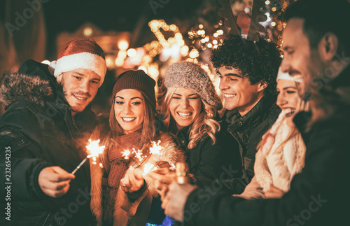 Friends With Sparklers At The New Year Party