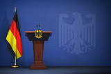 Press conference  of premier minister of Germany concept, Politics of Germany. Podium speaker tribune with Germany flags and coat arms. - 232655045