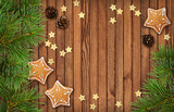 Christmas decorations and cookies on wood