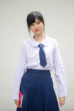 Portrait of thai high school student uniform teen beautiful girl happy and relax - 232659670