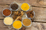 Variety of spices on wooden background - 232660801