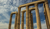 tourism to ancient heritage of antique columns ruins of old temple buildings in area of outdoor open air museum, blue sky background - 232666849