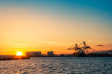 Commercial harbor at sunset - 232668647