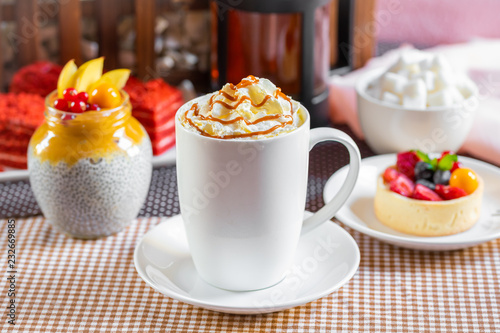 Poster cup of coffee with whipped cream and dipping