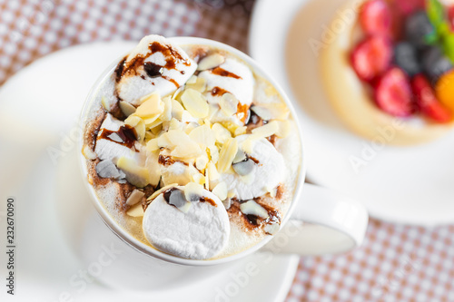 Poster cup of coffee with marshmallow and topping with nuts