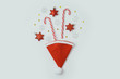 Christmas holiday concept with santa hat and decorations on white background