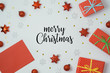 Christmas holiday background with greeting card, gift boxes and decorations on white table