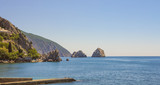 Picturesque Bay of the Black sea with separate rocks on the horizon.Crimea. - 232685883