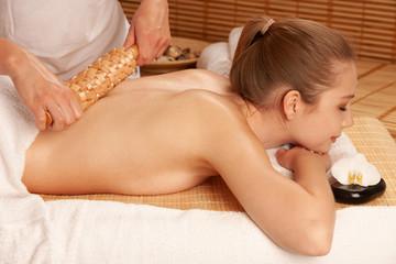 Beautiful young woman having a maderotherapy massage  treatment in spa salon - wellness © Samo Trebizan