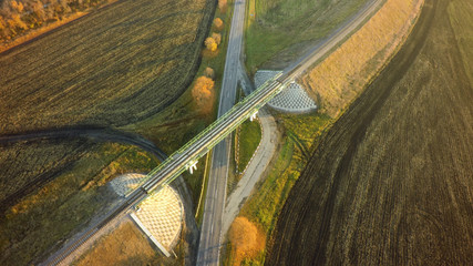 Aerial Top View repair highway intersection junction summer morning with car © Chepko Danil