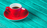 red cup of coffee on blue color wooden table. - 232695831