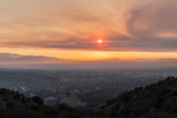 Los Angeles, California, USA - November 10, 2018:  Smoke filled sunrise sky above the San Fernando Valley.  Smoke is from the Woolsey fire in Malibu and Ventura County.    - 232709809
