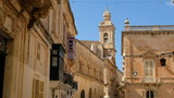 Mdina, Malta. View from St, Paul´s Square. At the center, the tower of the Carmelite Priory. Just at its left, a partial view of Palazzo Santa Sofia. It´s groundfloor was built in the 13th century. - 232709842