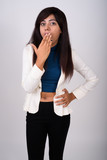 Studio shot of young Persian businesswoman standing while lookin - 232710832
