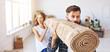 Leinwandbild Motiv happy young married couple moves to new apartment
