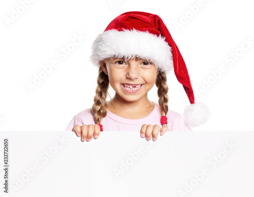 871ad34726e Portrait of happy little girl in Santa hat with white blank. Child wearing Santa  Claus
