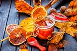Apple-pumpkin jam with orange decorated with autumn leaves.Autumn season