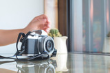 Digital camera on glass table in coffee shop - 232734265