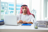 Arab businessman working in the office - 232741880