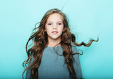 lifestyle  and people concept: litle girl kid with long curly ha