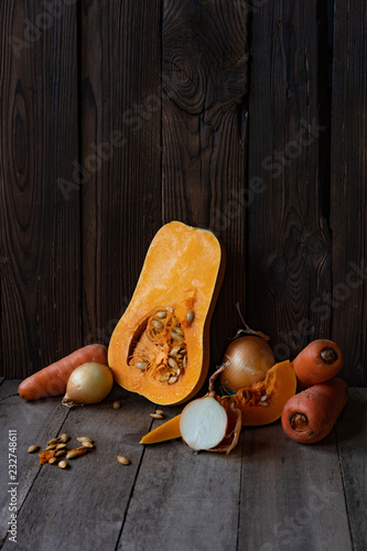 Poster sliced ​​pumpkin and carrots are on the table