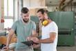 Leinwanddruck Bild - two worker in a carpenter's workshop