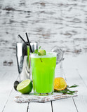 Cocktail Jungle Juice. Green Alcoholic Cocktail. On a wooden background. Top view. Free copy space. - 232754027
