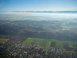 helicopter view from top to munich and bavarian landscape during fog autumn blue sky - 232764631